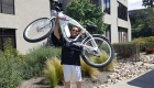 Phantom Bikes owner, John King, lifting the Phantom R bicycle